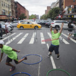 Children hula hoop and race on the streets of Harlem during Concrete Safari's 5th Annual Obstacle race and Active living fair in Harlem on August 29, 2017.